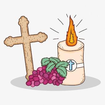 Primera comunión con cruz y vela con uvas.