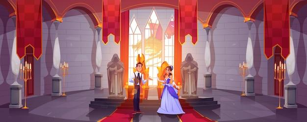 Príncipe y princesa en la sala del trono en el salón del castillo