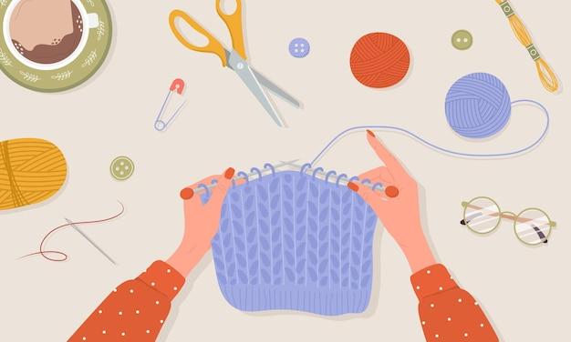 Proceso de tejido. manos femeninas con agujas e hilo.