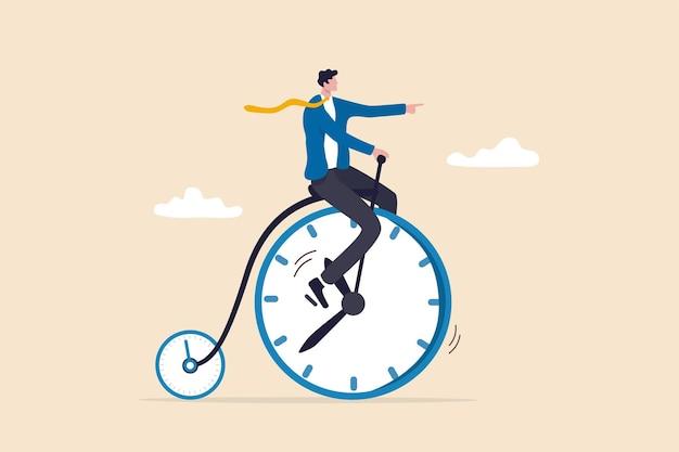 La productividad o la eficiencia dedican tiempo a terminar el trabajo, la gestión del tiempo o el concepto de equilibrio de la vida laboral, el empresario monta una bicicleta vintage con la rueda delantera como reloj y la rueda pequeña como cronómetro.