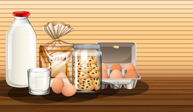 Productos horneados con botella de leche y dos huevos en grupo