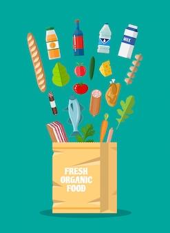 Productos orgánicos saludables frescos y bolsa de papel