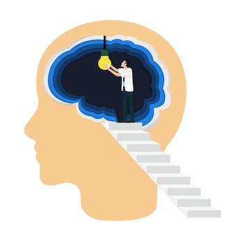 El profesional médico abre una bombilla dentro del cerebro como símbolo de la idea creativa.
