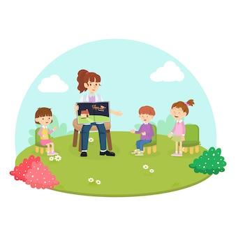 Profesor contando una historia sobre papá noel con niños de la escuela en las vacaciones de navidad.