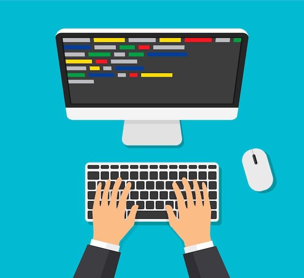 Programador trabajando escribiendo código. el hombre escribe en el teclado con. desarrollador web, diseño, programación.