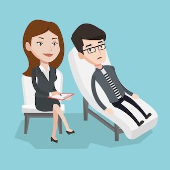 Psicólogo teniendo sesión con el paciente.