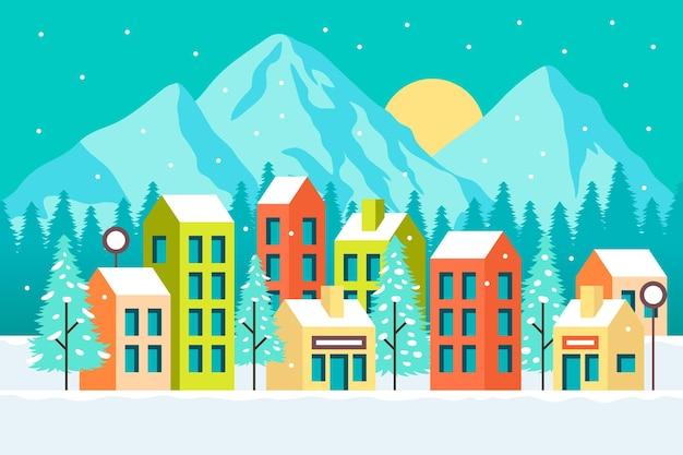 Pueblo ilustrado con nieve y montañas.