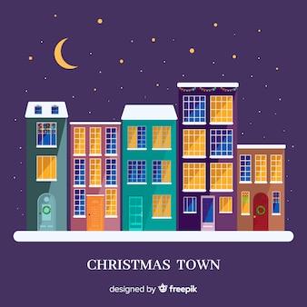 Pueblo navideño adorable con diseño plano