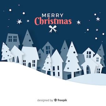 Pueblo navideño adorable con estilo de arte de papel