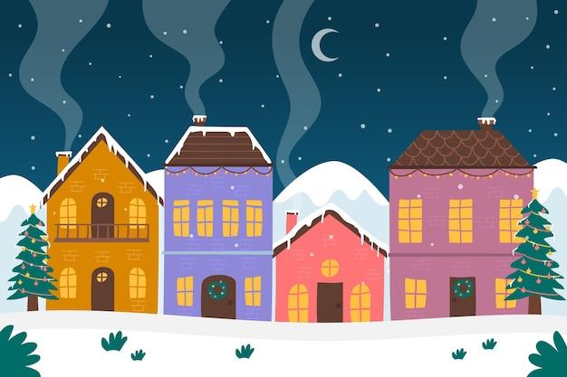 Pueblo navideño dibujado a mano en la noche