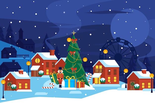 Pueblo navideño plano con gran abeto