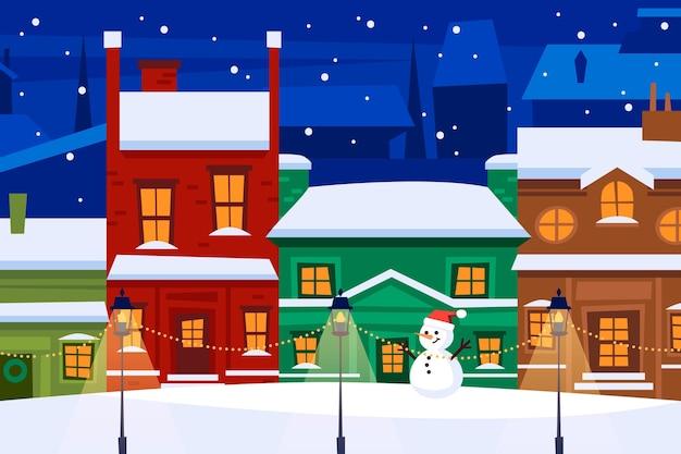 Pueblo nevado de navidad por la noche