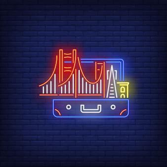 Puente y edificios en señal de neón maleta abierta