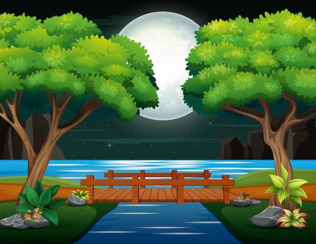 Puente de madera sobre el río en paisaje nocturno