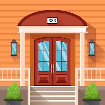 Puerta delantera de casa decorada por siding