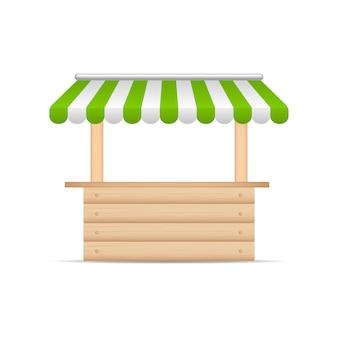 Puesto de madera del mercado con sombrilla verde y blanco.