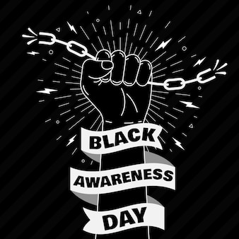 Puño sosteniendo cadenas día de concientización negra
