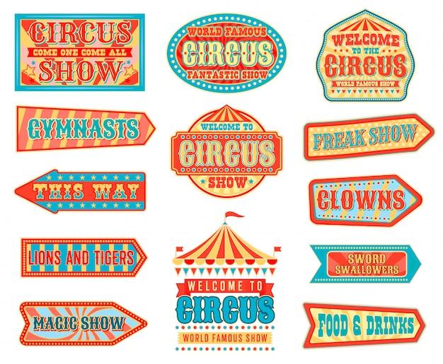 Punteros de flecha de circo con carpas superiores de carnaval