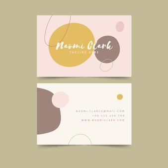 Puntos de manchas coloridas en plantilla de tarjeta de visita