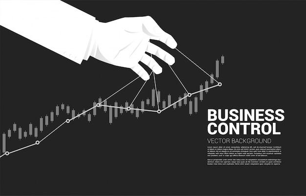 Puppet master que controla el gráfico creciente del negocio. concepto de manipulación y control de mercado.