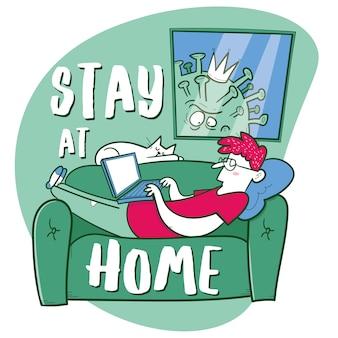 Quédate en casa. el hombre trabaja con una computadora portátil en el sofá. virus mira por la ventana