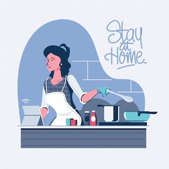 Quédese en casa en cuarentena durante la epidemia de coronavirus. mujer disfruta cocinar en la cocina
