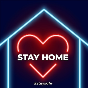 Quédese en casa, manténgase seguro corazón de neón y fondo de la casa