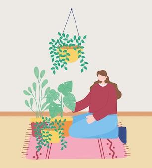 Quédese en casa, la niña cuida las plantas de interior, el autoaislamiento, las actividades en cuarentena para el coronavirus
