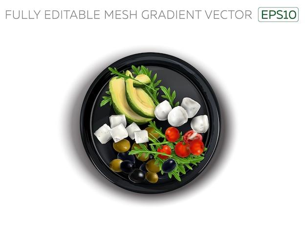 Queso feta y mozzarella con verduras en una placa negra.