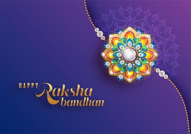 Rakhi decorado para el festival indio raksha bandhan, festival indio con oro y cristales sobre papel de color de fondo.