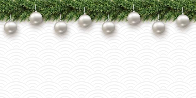 Rama de abeto con bolas de navidad sobre fondo de textura de patrones sin fisuras horizontales.