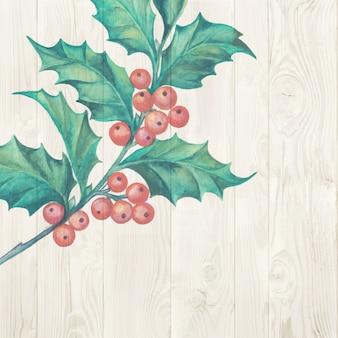 Rama de muérdago de navidad aislado sobre fondo de madera