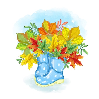 Un ramo de hermosas hojas de otoño en botas de goma azul brillante.