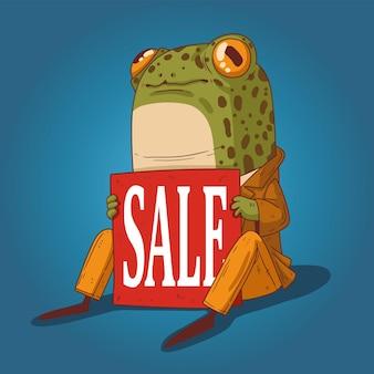Una rana caballero elegantemente vestida se sienta en el suelo con un cartel en sus manos que dice venta
