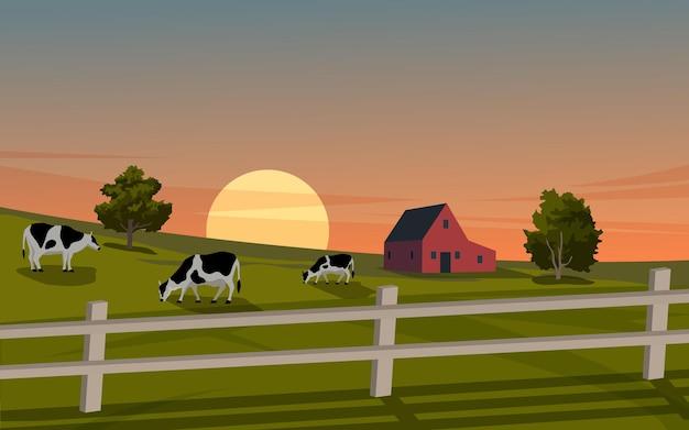 Rancho de campo al atardecer con granero y vacas
