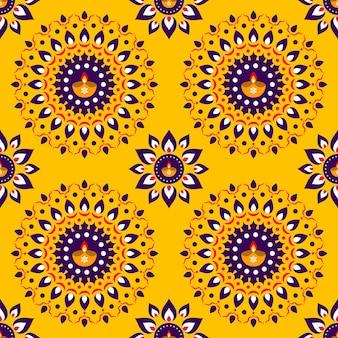 Rangoli floral transparente con lámparas de aceite (diya) decoradas sobre fondo amarillo.