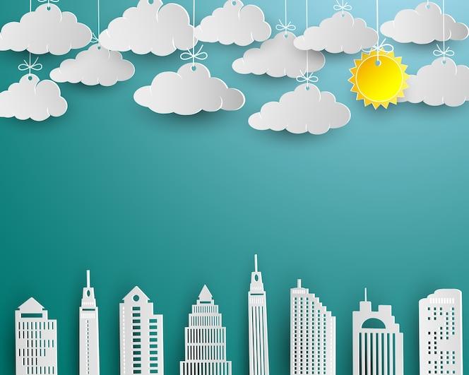 Rascacielos y nube en diseño de arte de papel blanco