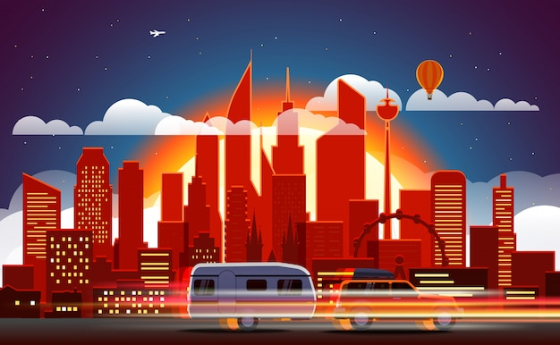 Rastros de coche en ciudad moderna con iluminación nocturna.