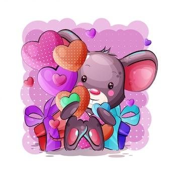 Ratón lindo bebé de dibujos animados con corazones y caja de regalo