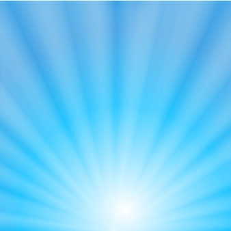 Rayos de sol en el fondo del cielo azul