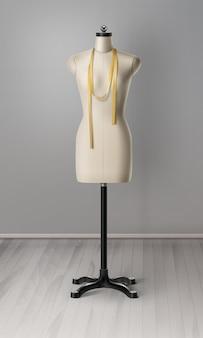 Realista de maniquí para taller de costura. espacio de trabajo con cinta métrica y maniquí.