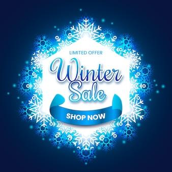 Rebajas de invierno azul con copos de nieve brillantes
