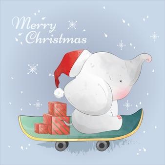 Regalo de navidad en el camino con bebé elefante