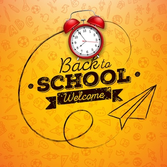 Regreso a la escuela con despertador rojo y letra de tipografía en amarillo.