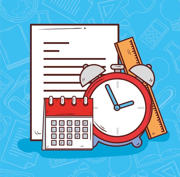 Reloj despertador con calendario y útiles escolares.
