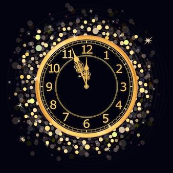 Reloj dorado de año nuevo