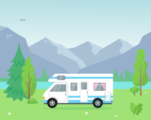 Remolque de camping cerca del lago y las montañas.