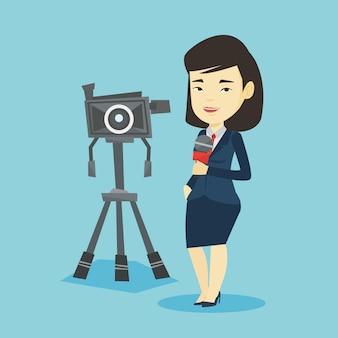 Reportero de televisión con micrófono y cámara.