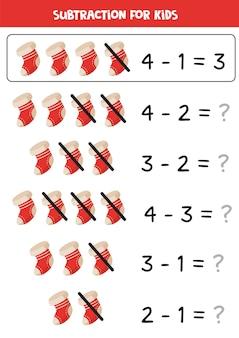 Resta con calcetines navideños rojos. juego educativo de matemáticas para niños.
