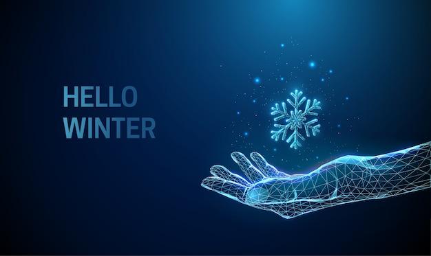 Resumen dando la mano con copo de nieve cayendo. diseño de estilo low poly. hola concepto de invierno. fondo geométrico moderno. estructura de conexión de luz de estructura metálica. ilustración aislada.